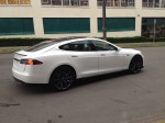 Model S drives away