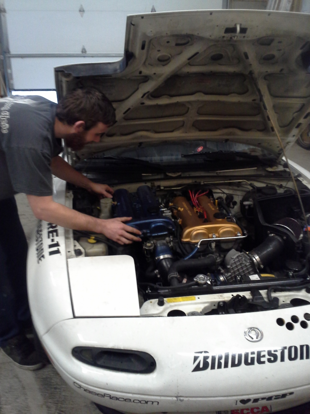 What happens when you have two valve covers? TJ tries to pretend that you have V8 swapped in...